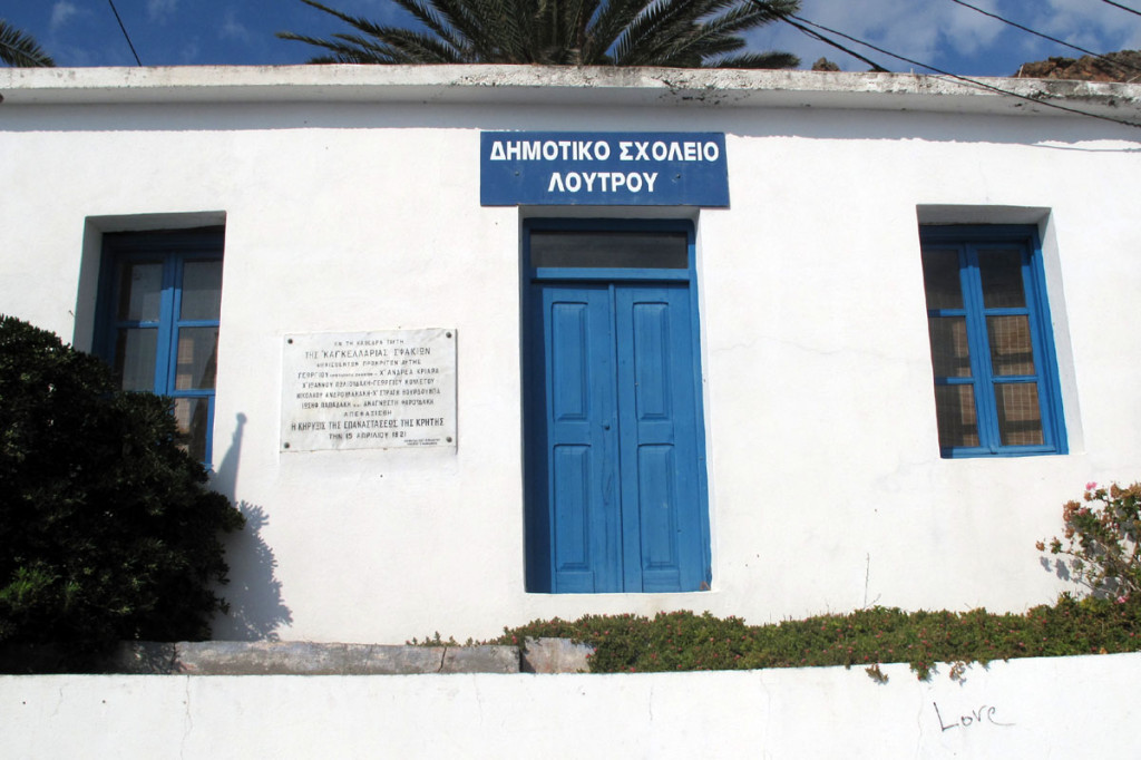 Located on the wall of the primary school building at the harbor of Loutro